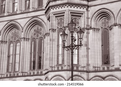 Detail on Town Hall, Manchester by Waterhouse (1877), England, UK with Lamppost in Black and White Sepia Tone