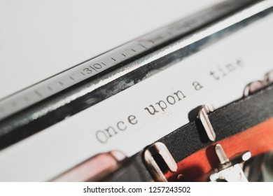 """Detail of """"Once upon a time"""" fairy tale opening text on white paper printed with old style typewriter"""