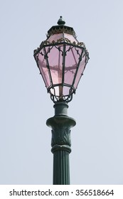 Detail of one beautiful pink street light in Venice, Italy