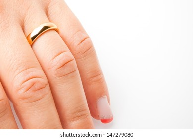 detail of one hand with gold ring with space for text on white background