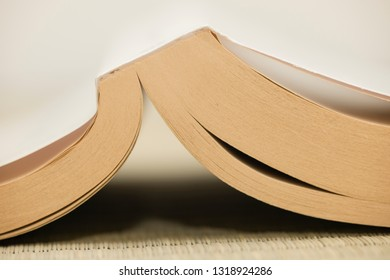 Detail of open book with dog-ears bookmarks.