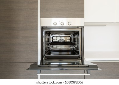 Detail of open kitchen oven. Copy space