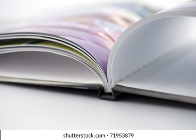Detail of open photo book on white background
