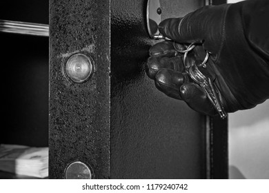 Detail of Open Safe with Hand of Thief