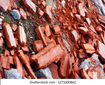 Detail of orange dumped bricks