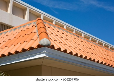 Detail of an overlapped barrel tile roof with cement mortared joints.