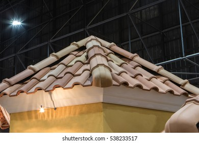 Detail of overlapping roofing tiles on a new build cement house
