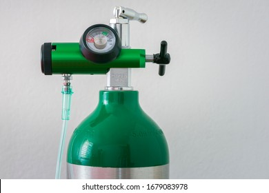 Detail of an oxygen pressure gauge and cylinder with white background
