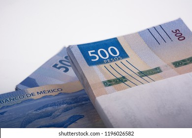 detail of packages of mexican 500 peso bill on white background