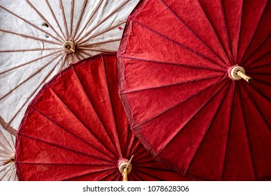 Detail of paper and bamboo umbrella in red and white color