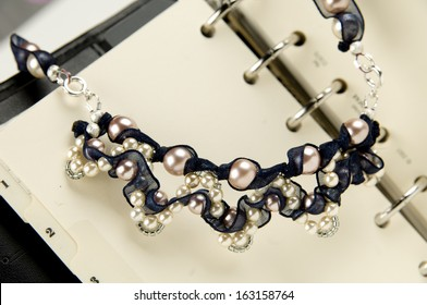 Detail of pearl necklace