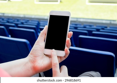 detail of people using smart phone in the soccer stadium