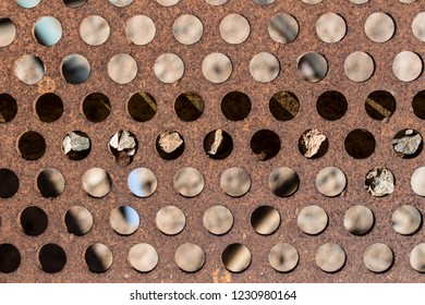 detail of perforated and rusty metal, rusty and leaky metal plate, metal corroded texture, rusty metal background, brown