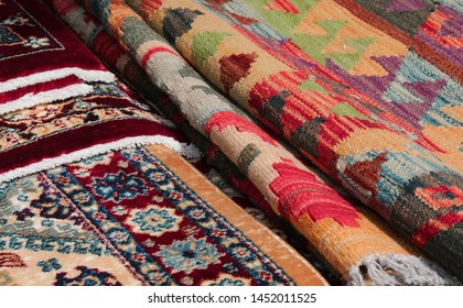 detail of Persian rugs and carpets kilim type for sale in the ethnic market stall
