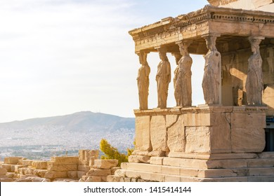 Detail photo of iconic Caryatids statues in porch of Caryatids located on top of Acropolis hill next to iconic masterpiece Parthenon, Athens historic center, Attica