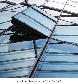 detail picture of a glass facade with open windows
