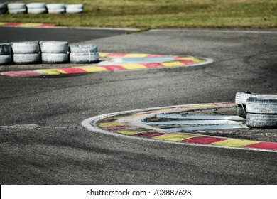 A detail picture of a part of the racetrack. The chicane with kerbs and tyres can be seen.