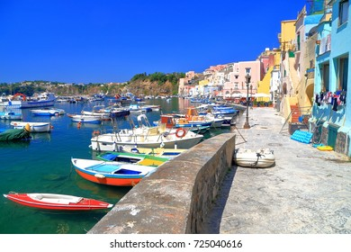 Detail of the pier and harbor of Marina Corricella on the island of Procida, bay of Naples, southern Italy