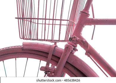 Detail of a pink vintage bicycle with basket