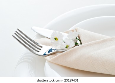 detail of place setting with fork knife and little flower