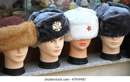 Detail of plastic heads with caps in various colors.