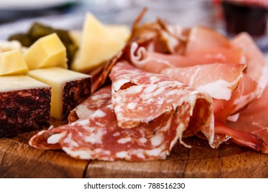 Detail of a plate of speck and typical italian salami with cheese and pickles, Cortina D'Ampezzo, Italy
