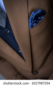Detail of pocket square of man in tailored suit