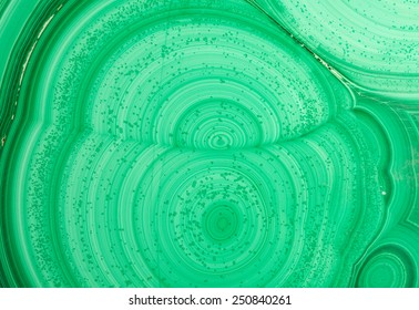 Detail of the polished slab of layered green malachite