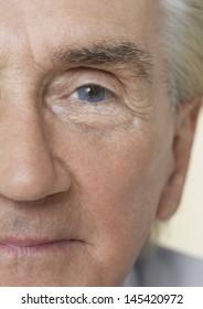 Detail portrait shot of a senior man's face with blue eye