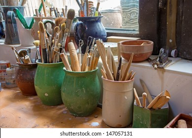detail from pottery work room - brushes and tools