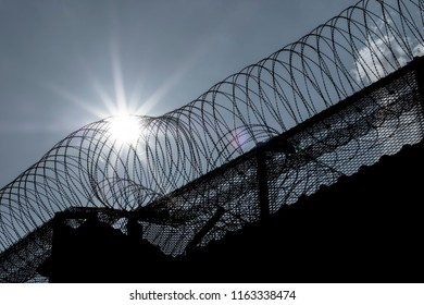 Detail of prison walls with barbed wire