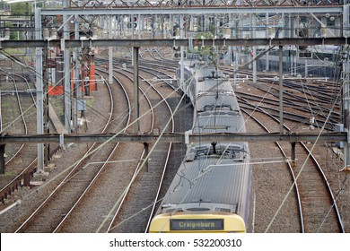 Detail of rail tracks and overhead electricity supply in Railway Yard