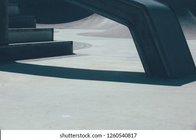 Detail of the railing and the stairs used as obstacle to make tricks in an empty urban skate park. Useful as a background.
