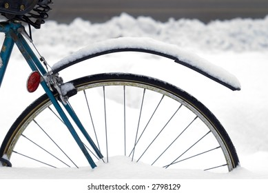 Detail of a Rear Bicycle Wheel Buried in a Snow Bank