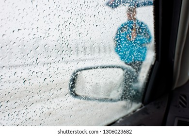 Detail of rear-view mirror in the rainy weather