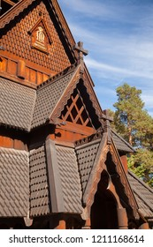 Detail of reconstructed wooden Gol Stave Church (Gol Stavkyrkje) decorated with dragons and crosses in Norwegian Museum of Cultural History at Bygdoy peninsula in Oslo, Norway, Scandanavia