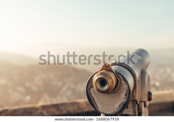 Detail recording binoculars and a vantage point in the sunshine over Wernigerode