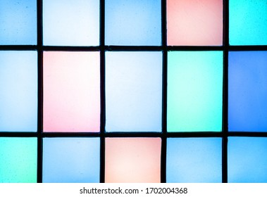 Detail of rectangular shaped blue colored light panes from stained glass window. Design and interior concept.