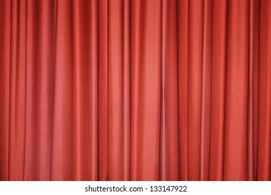 Detail of a red closed curtain in a theater