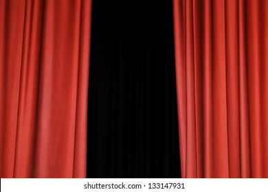 Detail of a red rising curtain in a theater