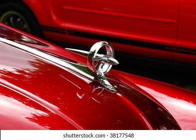 Detail of red shiny chrome plated antique car
