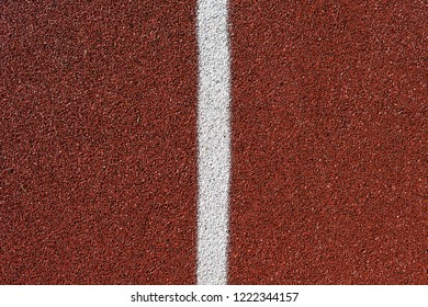 detail of the red tartan surface with white line, sporting terrain, life of the athlete