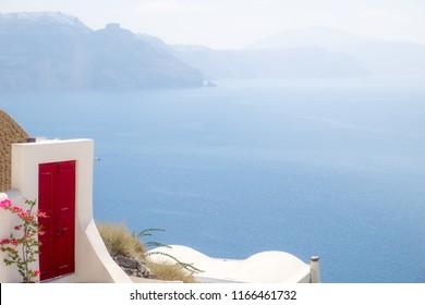 Detail of red terrace door with ocean background, Santorini, Greece