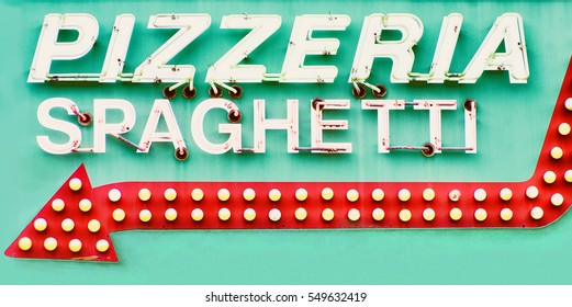 Detail of restaurant sign with words pizzeria and spaghetti