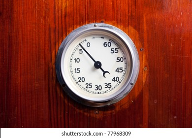 Detail of a retro manual timer attached to a wood background
