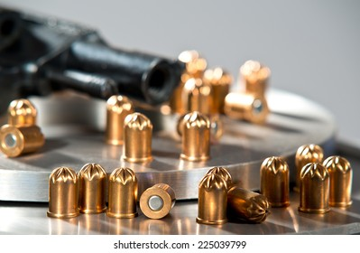 detail of a revolver with blank cartridges