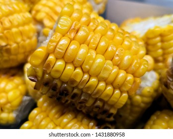 Detail of a roasted cob with delicious corn kernels