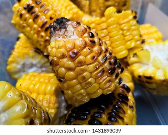 Detail of a roasted cob with some burned corn