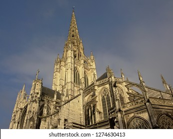 Detail of the Roman catholic Saint Maclou church in flamboyant gothic style with spires and arches in Rouen, France