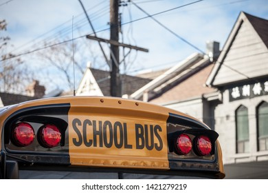 Detail of the roof of a North American Yellow School Bus parked on a street, waiting for students in a residential area of Toronto, Ontario, Canada